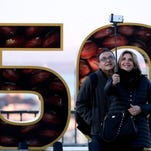 Juan Kallsmadella and Ester Carne take a selfie with a Super Bowl 50 sign at Twin Peaks park overlooking San Francisco Thursday, Feb. 4, 2016. (AP Photo/Charlie Riedel)