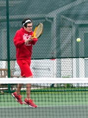 Port Clinton junior Jacob Koch hits during a set against Oak Harbor at Port Clinton on Tuesday afternoon.