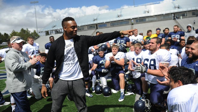 Current NFL player and ex-Wolf Pack linebacker Brandon Marshall addresses the team following its Silver and Blue spring scrimmage in 2015. Marshall will have his number retired by Cimarron-Memorial High School on Friday.