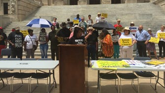 The Poor People's Campaign gathered Monday afternoon outside the State Capitol to protest inequities and poverty before marching to the governor's mansion.