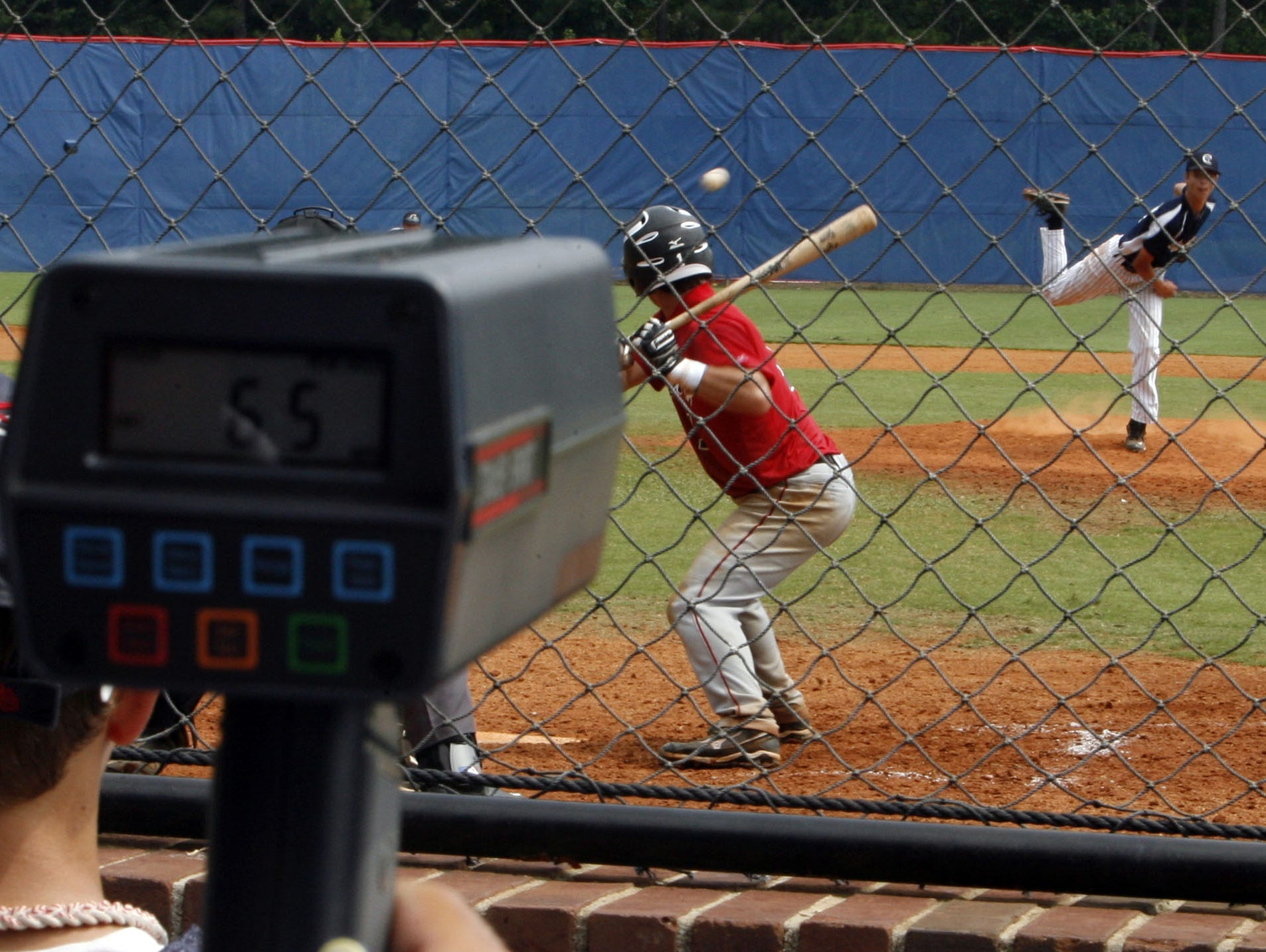 A college coach uses a radar gun to determine the pitch speed of a pitch by Stephen Hill of Carmel during the Perfect Game Invitational Baseball Tournament in Marietta, Ga. July 12, 2011. Hill plays for the World Yacht Clippers, which is comprised of high school baseball players primarily from Lower Hudson region. Thousands of the best high school baseball players in the nation gathered for two weeks to play games in front of college and professional scouts in the hope of receiving scholarships to colleges or being pursued major league organizations. ( Seth Harrison / The Journal News )
