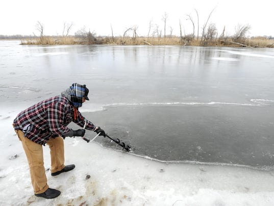 Warm weather is bad news for ice fishers for Michigan fishing license cost 2017