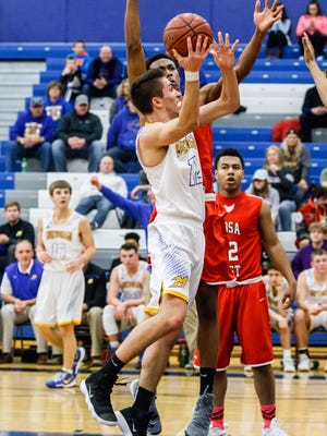 Mukwonago senior Connor Tess (12) elevates for a shot during the Luke Homan Memorial Showcase game against Wauwatosa East at Brookfield Central on Saturday, Jan. 20, 2018.