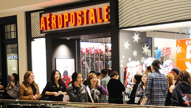 Shoppers wait to enter the Aeropostale store November 26, 2010.