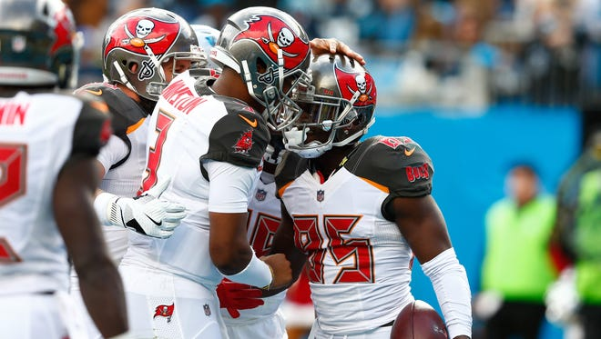 Tampa Bay Buccaneers quarterback Jameis Winston (3) celebrates with wide receiver Bobo Wilson (85) in the fourth quarter at Bank of America Stadium.