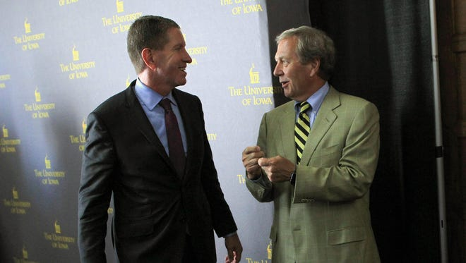 Iowa Board of Regents President Bruce Rastetter, left, chats with newly appointed University of Iowa President J. Bruce Harreld at the Iowa Memorial Union on Thursday, Sept. 3, 2015.