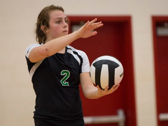 Kylie Murr get ready to serve in Yorktown's match against