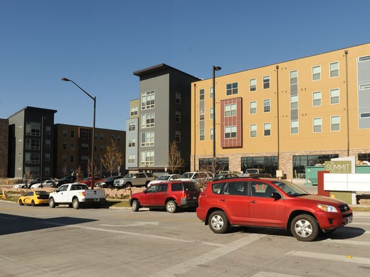 A car drives onto College Avenue near The Summit on College student housing complex in this file photo.