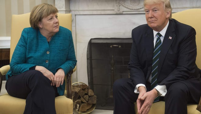 President Donald Trump and German Chancellor Angela Merkel meet in the Oval Office.