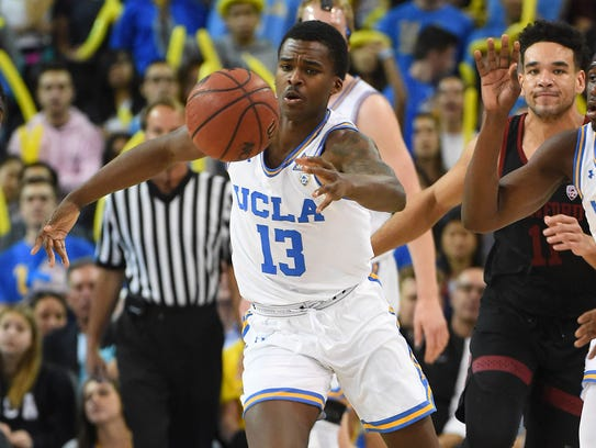 UCLA Bruins guard Kris Wilkes (13) reaches for a loose