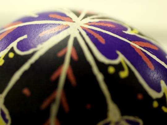Pysanka requires a steady hand as a design is lightly penciled on an egg shell and then drawn over with a stylus that dispenses hot beeswax.