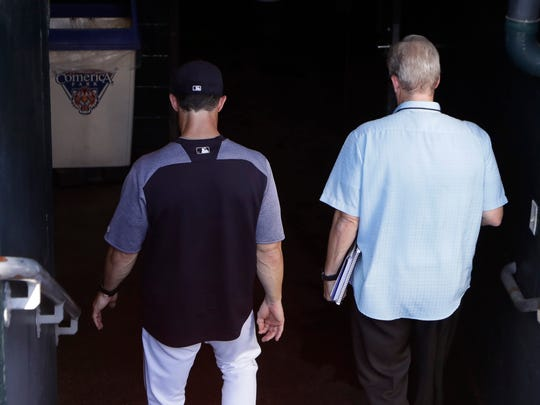Tigers manager Brad Ausmus, left, and Dan Dickerson, team radio play-by-play voice, walk to the clubhouse before a game against the Twins, Friday, Sept. 22, 2017 in Detroit. The Tigers will not bring back Ausmus next season.