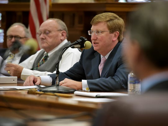 Lt. Gov. Tate Reeves, center, questions department heads about travel expenses during a budget meeting at the state Capitol.
