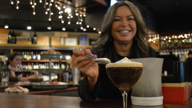 Sabrina Wilson, bartender at Liquid Assets, prepares the Wide Awake Drunk martini.