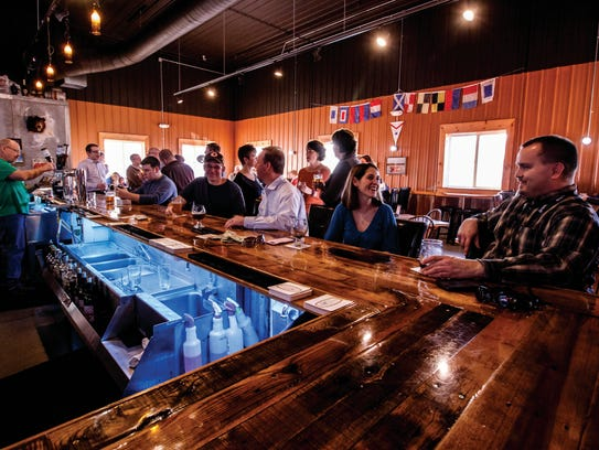 Patrons pony up to the bar at Sweet Mullets on Friday,