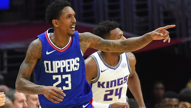 Los Angeles Clippers guard Lou Williams (23) heads down court after a three point basket in the second half of the game against the Sacramento Kings at Staples Center.