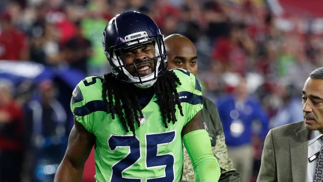Seattle Seahawks cornerback Richard Sherman (25) walks the bench after an injury during the second half of an NFL football game against the Arizona Cardinals, Thursday, Nov. 9, 2017, in Glendale, Ariz.
