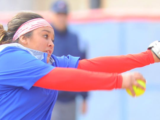 Cooper pitcher Camille Scott gets ready to throw a