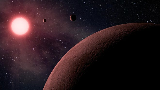 This artist rendering provided by NASA/JPL-Caltech shows some of the 219 new planet candidates, 10 of which are near-Earth size and in the habitable zone of their star identified by NASA's Kepler space telescope. NASA says its planet-hunting telescope has found 10 new planets outside our solar system that are likely the right size and temperature to potentially have life on them.