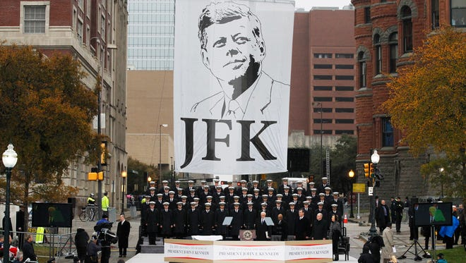 The United States Naval Academy Glee Club performs during a ceremony to mark the 50th anniversary of the assassination of John F. Kennedy, Nov. 22, 2013, at Dealey Plaza in Dallas.