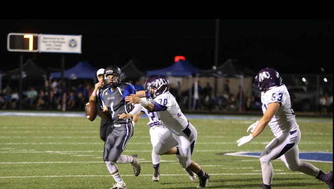 Quarterback for the Panthers, Carson Clowers (1), looks down the field while breaking through Mangham's defense.  Sterlington won, 35-12.