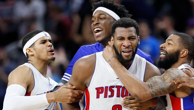 Detroit Pistons center' Andre Drummond (0) celebrates with teammates, from left, Tobias Harris (34), Stanley Johnson and Marcus Morris after scoring the winning basket to defeat the Milwaukee Bucks 92-91 during an NBA basketball game, Monday, March 21, 2016, in Auburn Hills, Mich.