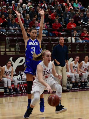Jim Ned's Brook Galvin drives the baseline past Brock's Mia Cherry as JNHS coach Hunter Cooley looks on during Brock's 39-35 win over the Lady Indians in a Region I-3A quarterfinal at Brownwood on Tues., Feb. 20, 2018.