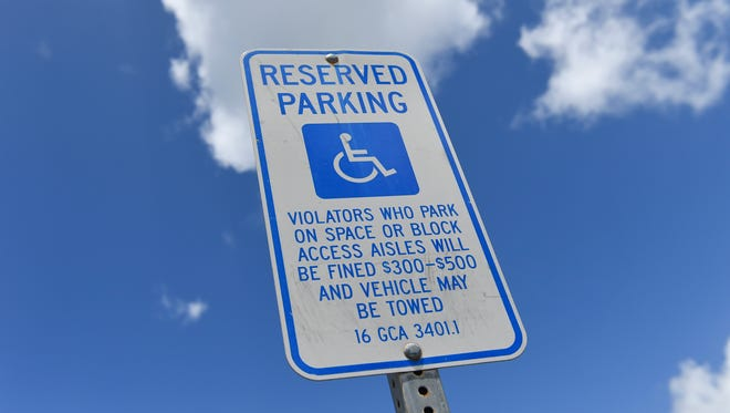 A reserved parking sign for people with disabilities at the Hagåtña Post Office on July 8, 2017.
