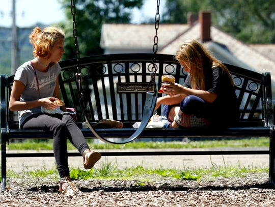 Lesley Church, left, eats lunch with her cousin Kayden