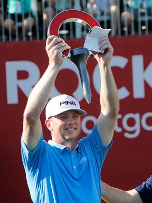 From June 30, 2019, Nate Lashley raises the winner's trophy after the final round of the Rocket Mortgage Classic golf tournament in Detroit. Lashley is playing the Scottsdale Open this week that features more than a dozen players with PGA Tour experience.