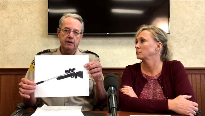 Sheriff Mike Milstead holds up a picture showing the type of pellet rifle Christopher Sanftleben was said to be holding.