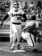 Rod Carew, future Hall of Famer, races towards first base during a California Angels spring training game in the 1980's at Palm Springs Stadium