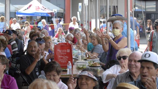 Seniors at Senior Fest 2013 applaud an entertainment performance. Senior Fest 2015 is Sept. 8 at Reno Town Mall