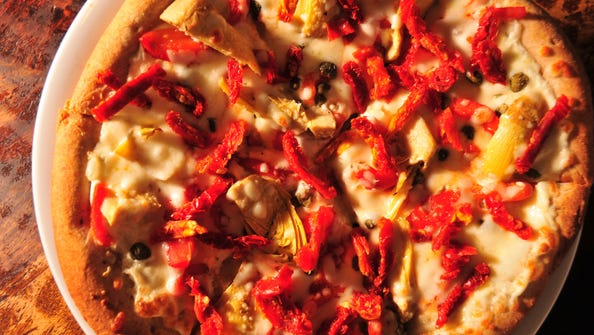Velvet Elvis in Patagonia, Arizona certainly isn't shy about mixing pizza ingredients-- check out their El Mariachi Blanco Designer Pizza: Green Chili & Jalapeno Cream Cheese Sauce, Capers, Roasted Red Peppers, Artichoke Hearts, Garlic and Sun-Dried Tomatoes.