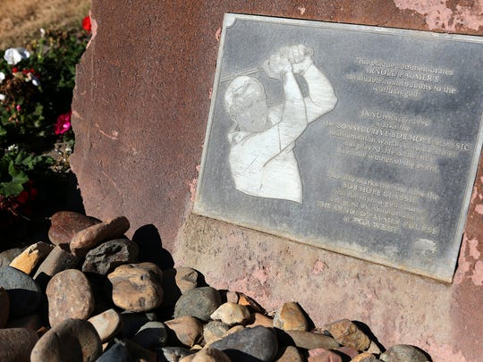 A plaque commemorating Arnold Palmer is embedded into