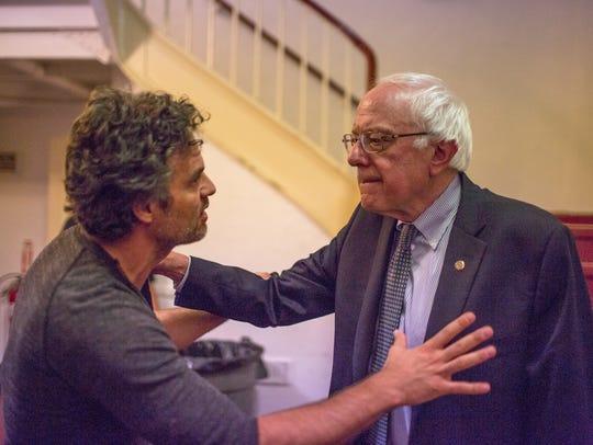Actor Mark Ruffalo (left) greets U.S. Sen. Bernie Sanders