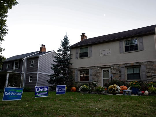 The lawn of Matt and Kate Borges' home is conspicuously missing a Donald Trump yard sign.(Eric George for The Enquirer)