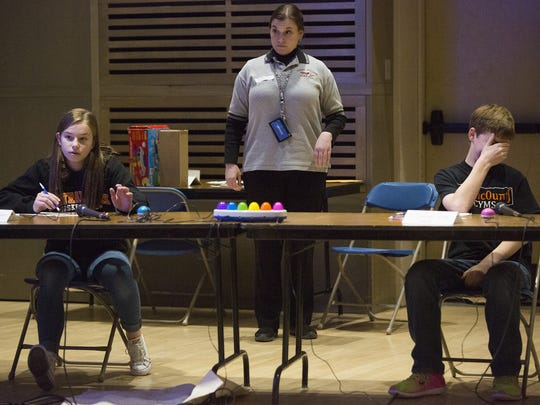 Central York Middle School's, Sarah Berman, left, answers a question as Dillon Linz, also a Central York student, reacts. The annual Mathcounts competition tests middle school students' problem solving abilities.