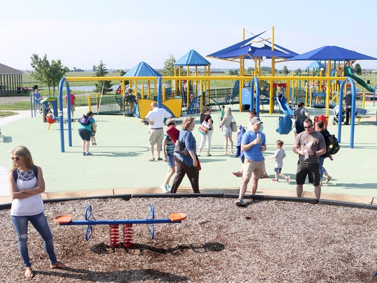 Children from the Green Acres Preschool, along with parents and siblings, enjoyed the state-of-the-art playground Wednesday at the new Can-Do Playground at Charles E. Price Memorial Park on Level Roads in Middletown.