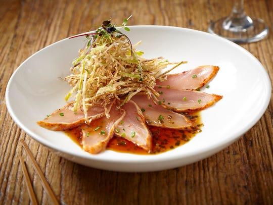 Chili albacore sashimi with crispy leeks at Sunda in