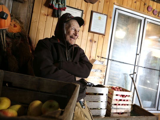 In a Thursday, Oct. 19, 2017 photo, Ken Weston, 88, owner of Weston's Antique Apple Orchard, reminisces about the early years of the business he operates with his sister, Genevieve Weston, in New Berlin, Wis.