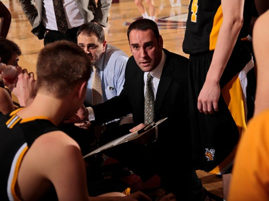 Scott Hundley, center, is the basketball coach at Woodford County (Ky.) High School. In the 2001 SEC Tournament, he was a freshman guard at Vanderbilt.