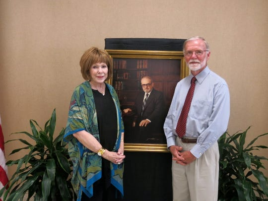 Susan Shelby and James Cureington, of Mountain Home, Ark., with a picture of the late Dr. Stan Shelby at dedication of a building at Willis-Knighton Health System-North in Stan's name.