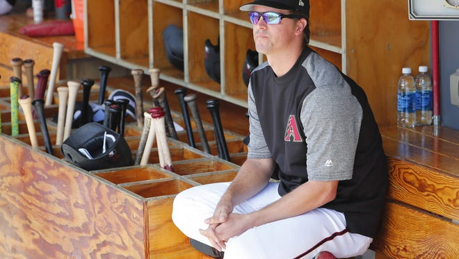 Arizona Diamondbacks starting pitcher Zack Greinke (21) watches his team warm up before a spring training game against the Chicago Cubs at Salt River Fields at Talking Stick March 4, 2018.