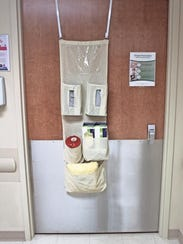 A door hanger for patients placed in isolation -- those