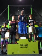 Alex Johnson, center, won the fourth Marianas Trench Throwdown at Chamorri CrossFit on Sunday, Oct. 11, 2015. Summerhays won prizes from Llamas With Barbells and MadFitter.