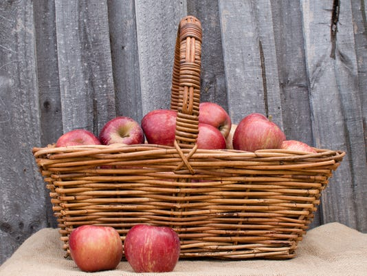 Wicker basket of red apples