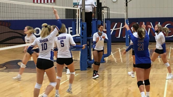 Seaman senior Camryn Turner (3) celebrates a kill with her Viking teammates during Tuesday's home volleyball triangular.