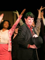 """Ken Hermens plays the amusing but evil corporate mogul Mr. Cladwell in """"Urinetown: the Musical"""" at Pentacle Theatre. The show runs through May 7 and is a satirical look at power, capitalism and bureaucracy."""