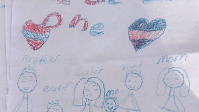 One of the cards made by children of families affected by the April 5, 2018, immigration raid on the Southeastern Provision meatpacking plant in Bean Station, Tenn.